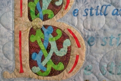 Closeup details of the outline of the applique and quilting design on the inside portion of the quilt