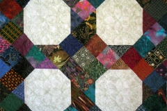Quilting details showing how the repeating pattern repeats at the same place within each block