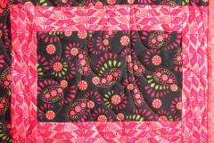 Quilting details showing design on inside quilt blocks