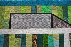 Details of the quilting and the goal area of the quilt