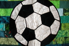 Closeup of the soccer ball which appliqued in the centre of the quilt