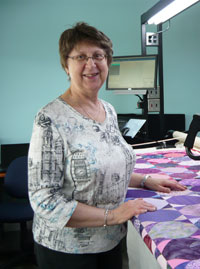 Miriam March at her Long-Arm Quilting Machine